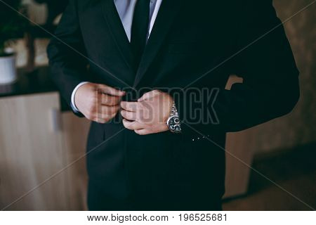 Elegant Groom In Wedding Jacket Wearing White Shirt And Turquoise Tie. Groom's Hands On Blue Suit.