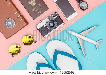 Summer travel fashion and objects on pastel background