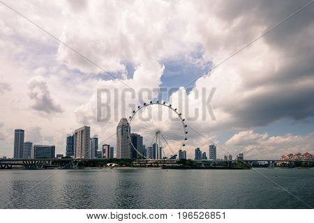 SINGAPORE - MARCH 22 2017: Great view from the Gardens by the Bay Park picture of Singapore Flyer in a cloudy day in Singapore.