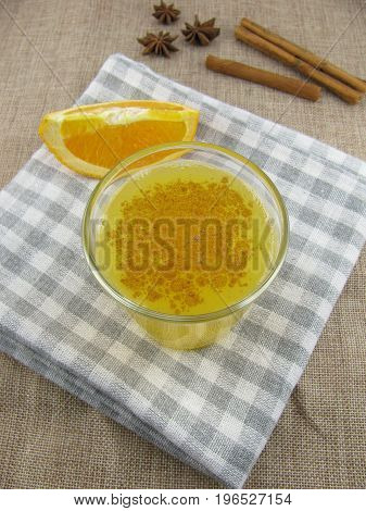 Fresh orange juice with mixed spices in a glass