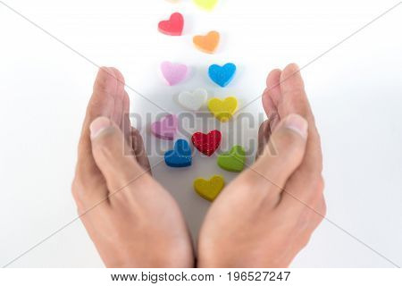 Colorful hearts sending out from hands on white background love concept
