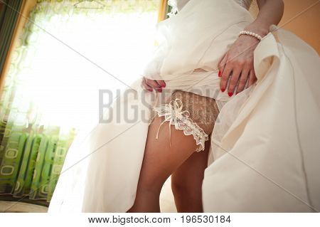 Bride Puts On The Garter