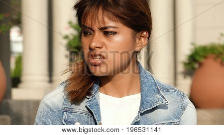 Peruvian Female And Anger and Wearing a Denim Jacket
