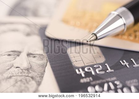 pen with credit card and dollar money. concept business economy finance.
