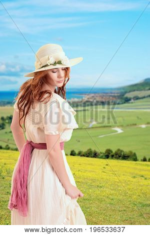 vintage woman on a hill over looking seaside town