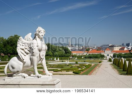 Beautiful Garden And A Statue Of The Sphinx In The Belvedere Palace. Vienna, Austria