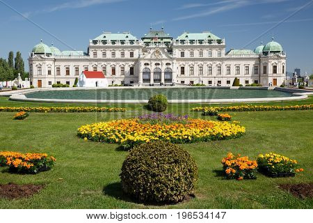 Panoramic View Of The Upper Palace Belvedere, Lake And Flower Beds. Vienna