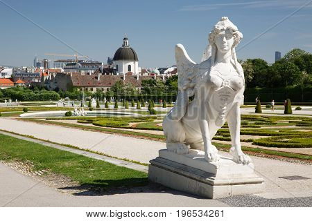 Sphinx Sculpture On Alley In The Garden Of Upper Belvedere Palace In Vienna