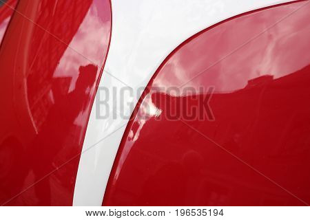 curved car form in red and white color glossy automotive paint