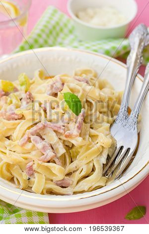 Pasta Carbonara style with bacon cheese cream and courgette zucchini