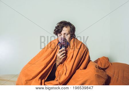 Man With Flu Or Cold Symptoms Making Inhalation With Nebulizer - Medical Inhalation Therapy