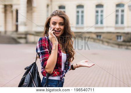 Young Woman Dressed In Sportswear With Smart Phone Traveling In The Old City Center