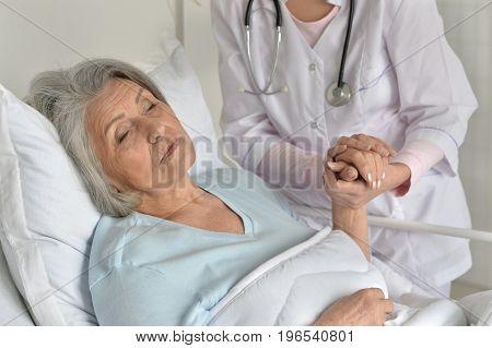 female doctor taking care of senior patient