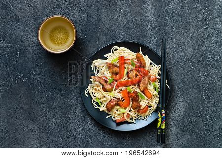 Szechuan Stir Fried Spicy Pork With Red Pepper And Green Onion, Mug Of Water. Chinese Food Or Asian