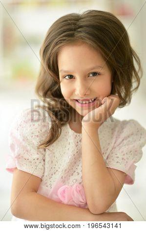 Portrait of beautiful little girl in white dress