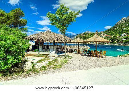 Amazing mediterranean outdoor beach bar with luxury beach resort Brela Makarska riviera Dalmatia Croatia Europe