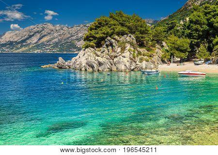 Fantastic summer landscape with Adriatic Sea Biokovo mountains and majestic bay Brela beach Makarska riviera Dalmatia Croatia Europe