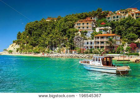 Typical mediterranean houses and fishing motorboat Makarska riviera Brela Dalmatia Croatia Europe
