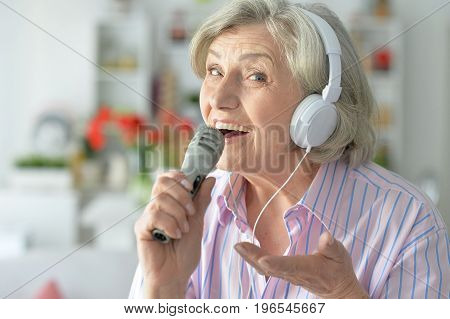Portrait of a senior singer woman in headphones