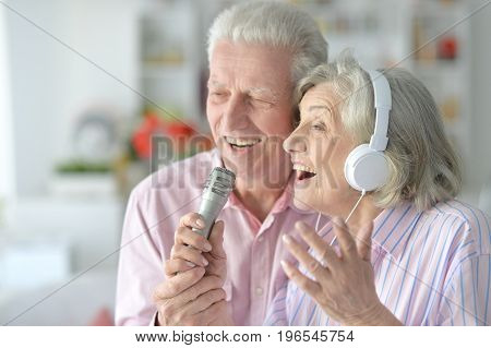 senior couple husband and wife singing songs