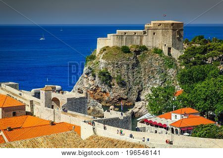 Amazing traditional Mediterranean houses with red tiled roofs and rocky coastline Dubrovnik Dalmatia Croatia Europe