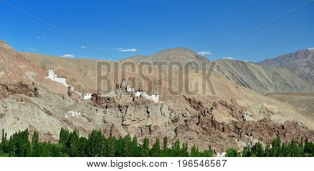 View on the beautifully located Buddhist monastery in the Basgo village in the background one can see the mountains, Ladakh is admiring the beautiful Karakorum panorama.