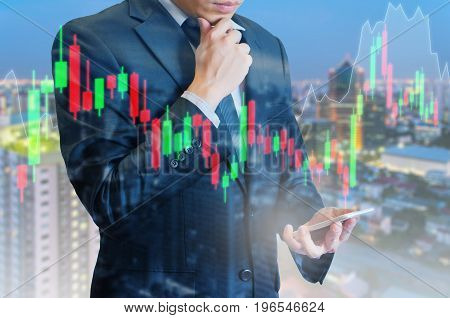 Double Exposure Of Professional Businessman Analyse Stock Candle Stick Graph Of Stocks Market On Dig