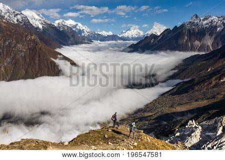 Trekker on the way to the valley covered with cloud on Manaslu circuit trek in Nepal