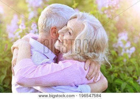 Close up portrait of senior couple hugging