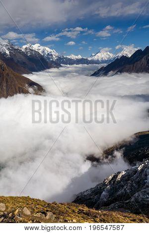 Manaslu valley covered with clouds on Manaslu circuit trek in Nepal