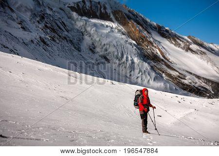 Trekker at the Thorung La pass - highesr point of Annapurna circuit in Nepal