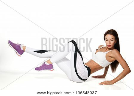 one woman exercising workout fitness aerobic exercise abdominal push ups posture on studio isolated white background. Clipping path included.