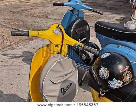 FORLIMPOPOLI, FC, ITALY - JUNE 19: yellow classic scooter Vespa with spare wheel cover parked during the italian scooter rally
