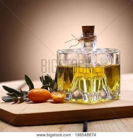 Homemade orange liqueur on wooden table. Selective focus.