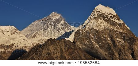 Close to the top of the world. Mount Everest and Cholatse in autumn seen from the Gokyo valley.