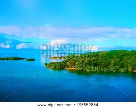 An aerial view of a tropical beach in Roatan Honduras early in the morning.