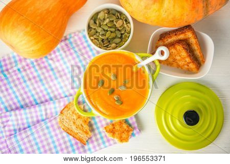Top View Of Creamy Pumpkin Soup Topped With Pumpkin Seeds And Bread In Bowl On Napkin, Healthy Lifes