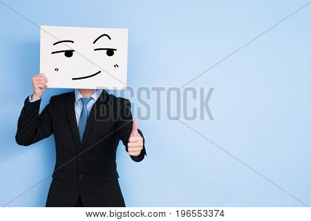 businessman take look somewhere billboard and thumb up on blue background