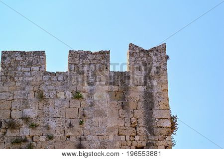 big old wall of ancient stone fortress for a background