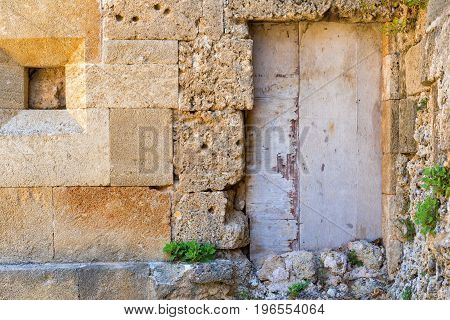 very old door on an ancient stone wall