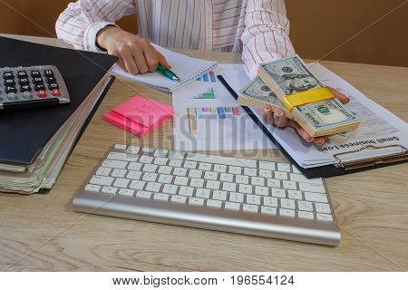 Hands close up. Loan credit debt concept. Hand giving money. woman holding stack of dollars