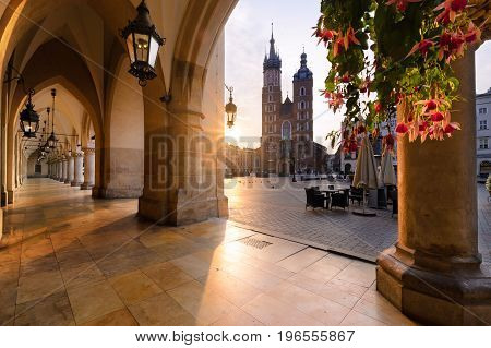Old city center view with St. Mary's Basilica in Krakow in sun lights.