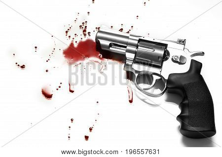 Beautiful revolver and red blood on a white