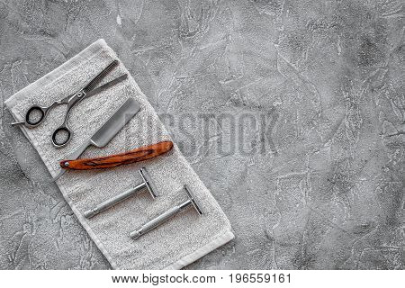 Accessories for shaving. Shaving razor on grey stone table background top view.