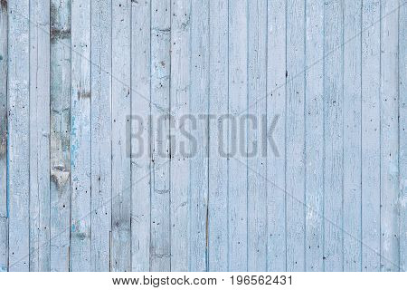 texture of wooden fence with a cracked blue paint