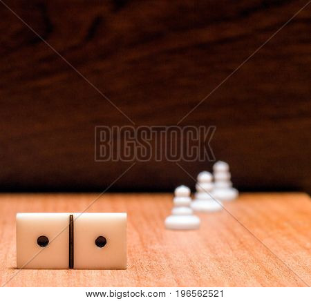 Plastic objects for popular board games such as dominoes and chess these figures are called pawns