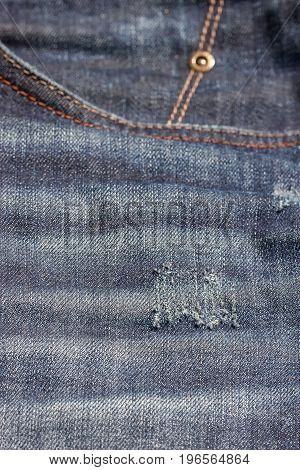 Blue jeans pocket with scuffs. Denim texture
