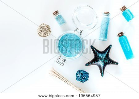Dead sea cosmetics. Sea salt, blue clay and lotion on white background top view.