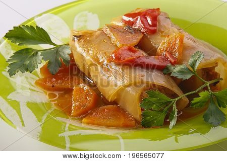 Dish of meat wrapped in a cabbage leaf. Stuffed cabbage is a traditional food of Eastern European, Central Asian cuisine. Meat or vegetable dish with rice. Studio.