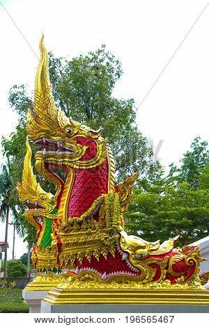 Red Naga sculpture on the stairs of Luang Phor Ngern statue at Wat Paknam Boong Sapang Ubonratchathani.